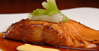 Beautifully plated salmon fillet. Glazed and served with a sauce.